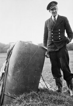 Hugh Syme, standing beside the first German Type C aerial magnetic mine to be recovered intact